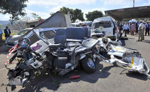 THAT'S A 14-SEATER NISSAN IN SUCH A WRECKED SHAPE BECAUSE OF CARELESS DRIVING